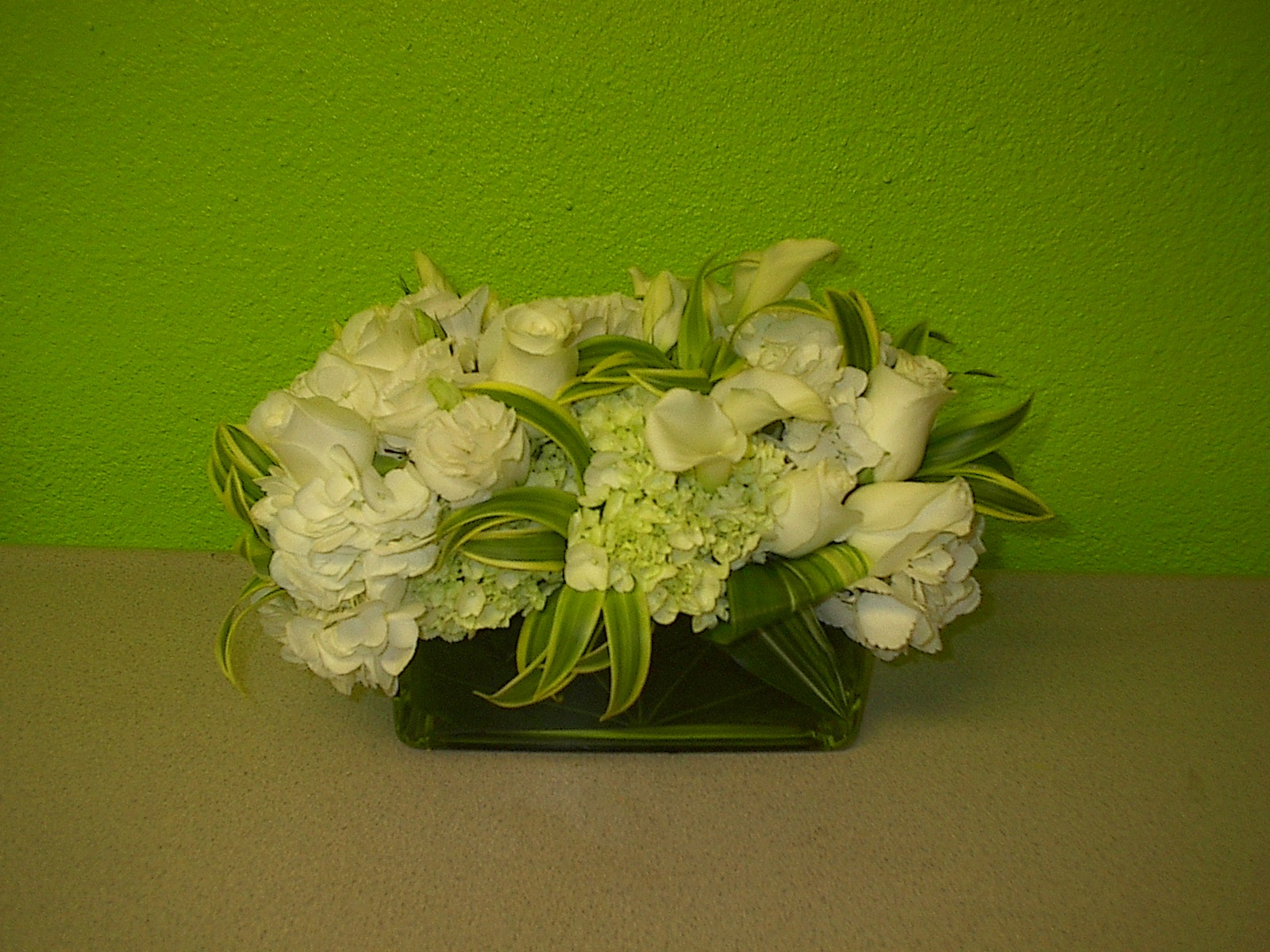 white flowers, calla lilies, low flower design for Convention in Las Vegas